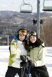 Two sisters skiing together Stock Photography