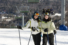 Two sisters skiing together Stock Photos