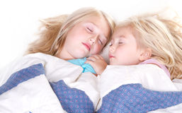 Two sisters sleeping Stock Images