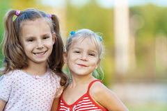 Two sisters are smiling royalty free stock image