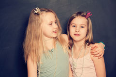 Two sisters smiling, portrait Royalty Free Stock Image