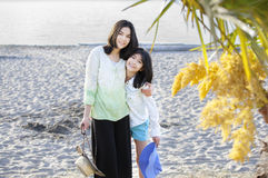 Two sisters standing on the beach Royalty Free Stock Photos