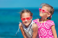 Two sisters standing on the beach Royalty Free Stock Image