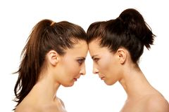 Two sisters standing face to face. Stock Photo