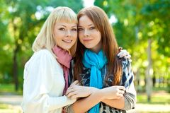 Two sisters standing in the park Stock Image