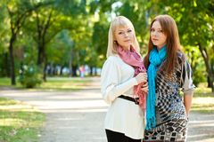 Two sisters standing in the park Royalty Free Stock Image