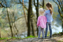 Two sisters taking a photo with a smartphone Royalty Free Stock Photos