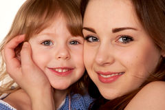 Two sisters, teenager and little girl. Face closeup. Royalty Free Stock Photo