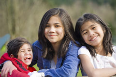 Two sisters and their disabled little brother Stock Photos