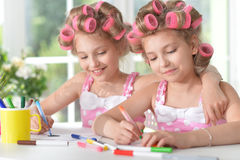 Two sisters twins drawing Royalty Free Stock Photos