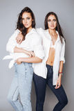 Two Sisters Twins Emotional Posing, Making Photo Selfie, Dressed Same White Shirt, Diverse Hairstyle, Bright Makeup