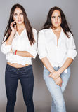 Two sisters twins posing, making photo, dressed Royalty Free Stock Photo