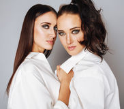 Two sisters twins posing, making photo, dressed Stock Images