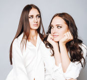 Two sisters twins posing, making photo, dressed Royalty Free Stock Photos