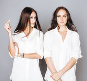 Two sisters twins posing, making photo selfie Royalty Free Stock Image