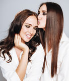 Two sisters twins posing, making photo selfie Royalty Free Stock Photo