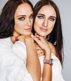 Two sisters twins posing, making photo selfie Royalty Free Stock Images