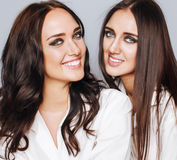 Two sisters twins posing, making photo selfie Stock Image