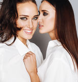 Two sisters twins posing, making photo selfie Royalty Free Stock Photography