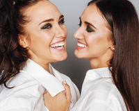 Two sisters twins posing, making photo selfie Royalty Free Stock Photos