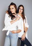 Two sisters twins posing, making photo selfie Stock Photo