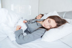 Two sisters twins sleeping in bedroom Stock Photos