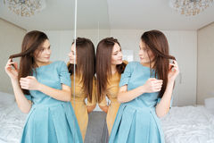 Two sisters twins standing and looking at the mirror Royalty Free Stock Images