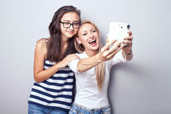 Two sisters using camera. Royalty Free Stock Images