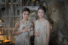 Two sisters in vintage dress Stock Images