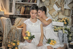 Two sisters in vintage white dress Royalty Free Stock Image