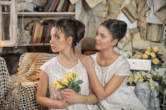 Two sisters in vintage white dress Stock Image