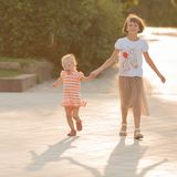 Two sisters walk in the park. Two sisters walk in  the park Stock Photo