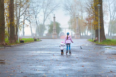 Two sisters walking in the park Stock Photo