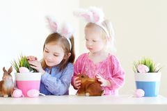 Two sisters wearing bunny ears on Easter Stock Photos