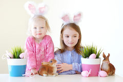 Two sisters wearing bunny ears on Easter Royalty Free Stock Photos