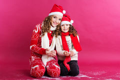 Two sisters is wearing christmas clothes Royalty Free Stock Image