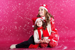 Two sisters are wearing winter clothes, christmas Royalty Free Stock Photography