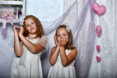 Two sisters in white dresses Royalty Free Stock Photo