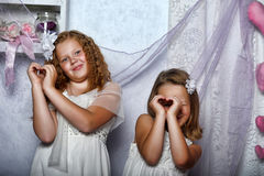 Two sisters in white dresses Royalty Free Stock Images