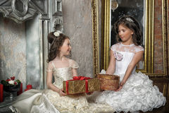 Two sisters in white evening dresses Stock Photo