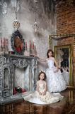 Two sisters in white evening dresses Royalty Free Stock Photos