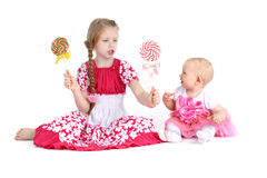 Two sisters 8 year and  11 month old  with candy Stock Photography
