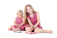 Two sisters 9 year and  1 year old Royalty Free Stock Image