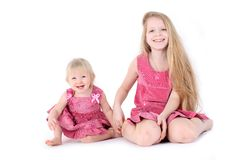 Two sisters 9 year and  1,9  year old Royalty Free Stock Images