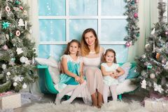 Two sisters and a young mother in a Christmas decorations Royalty Free Stock Photos