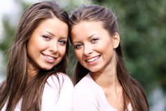 Two sisters young women Stock Images