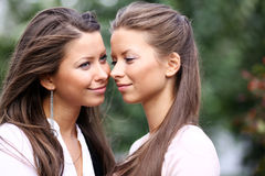 Two sisters young women Stock Photos