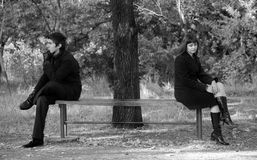 Two sitting at bench. Royalty Free Stock Images