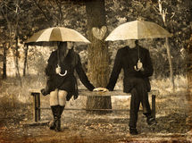 Two sitting at bench in rainy day. Royalty Free Stock Photos