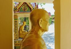 Two sitting golden budhas statues. Thailand royalty free stock photography